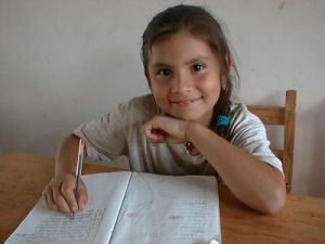 girl with notebook smiling