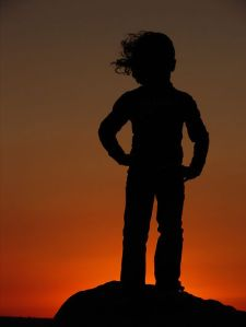 sillouette of young child in sunset